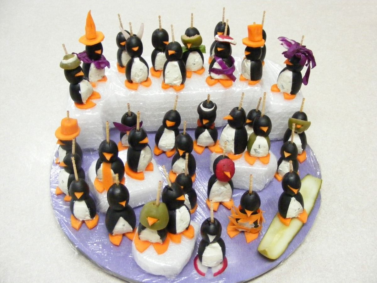 A whole family of party penguins made from olives, including a ...