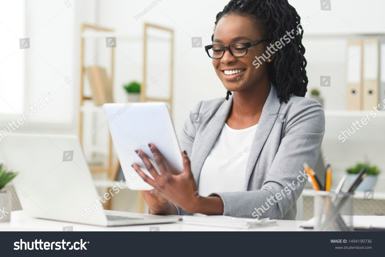 Business App. Afro Woman Using Tablet And Laptop Computer In Office. Free Space For Text ,