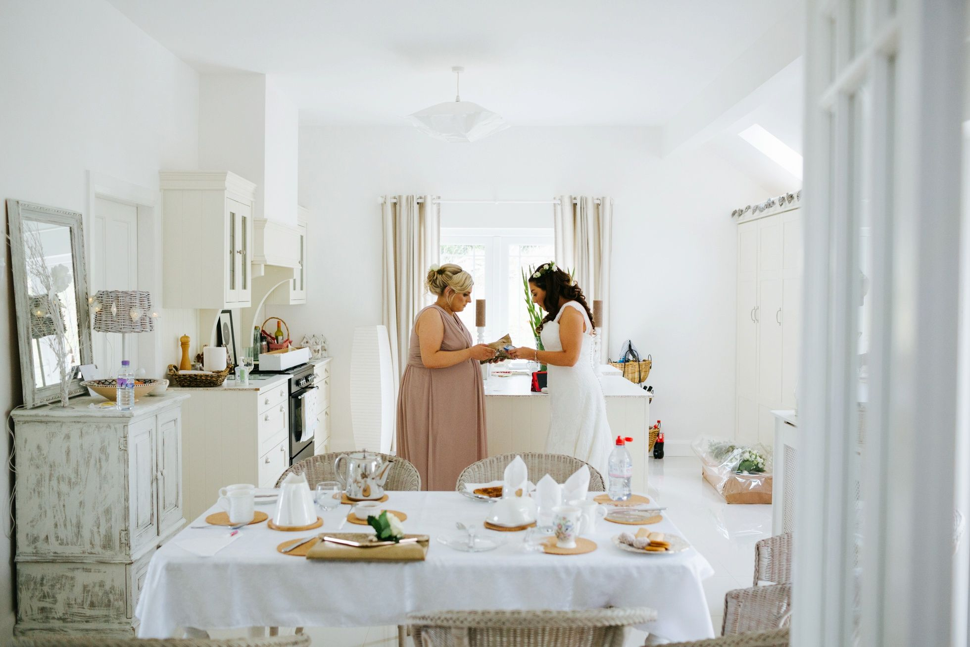 White | Bride and bridesmaid making their final preparations | William and Judiths Tullyglass Wedding Northern Ireland by Honey and the Moon Photography www.honeyandthemoonphotography.co.uk