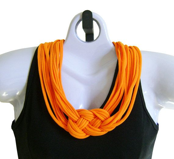 This handmade fabric necklace is a lovely Mandarin Orange color. It is lighter shade than the Bright Orange Necklace.  There are six strands