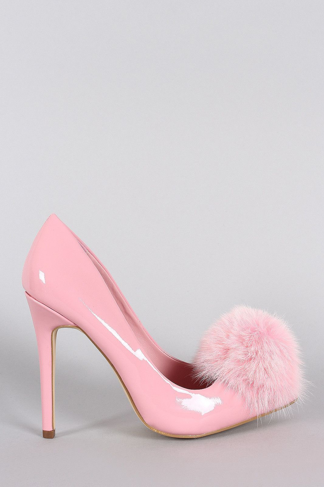 """Description        This lovely pointy toe silhouette, patent upper with eye-catching faux fur pom pom detail, single sole, and wrapped stiletto heel. Finished with lightly padded insole and easy slide style.    Material: Patent (man-made)  Sole: Synthetic      Measurement            Heel Height: 4.5"""" (approx)     