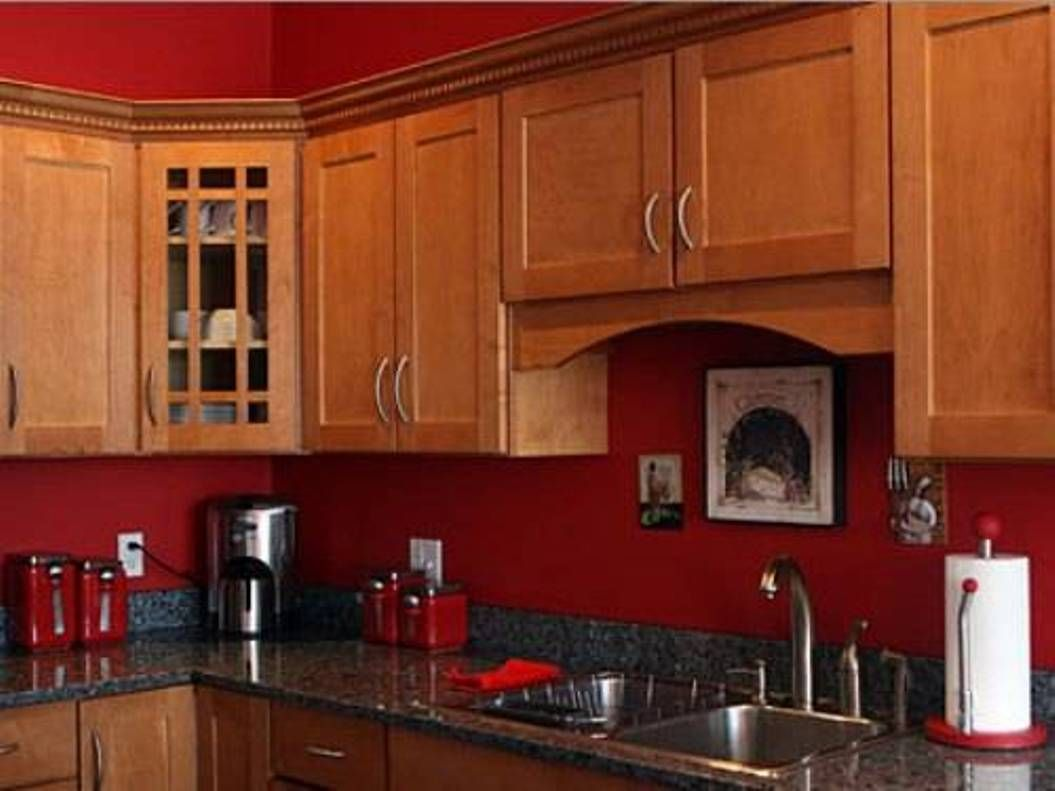 Oak Kitchen Cabinets With Red Walls Google Search Red Kitchen Walls Kitchen Color Red Kitchen Paint
