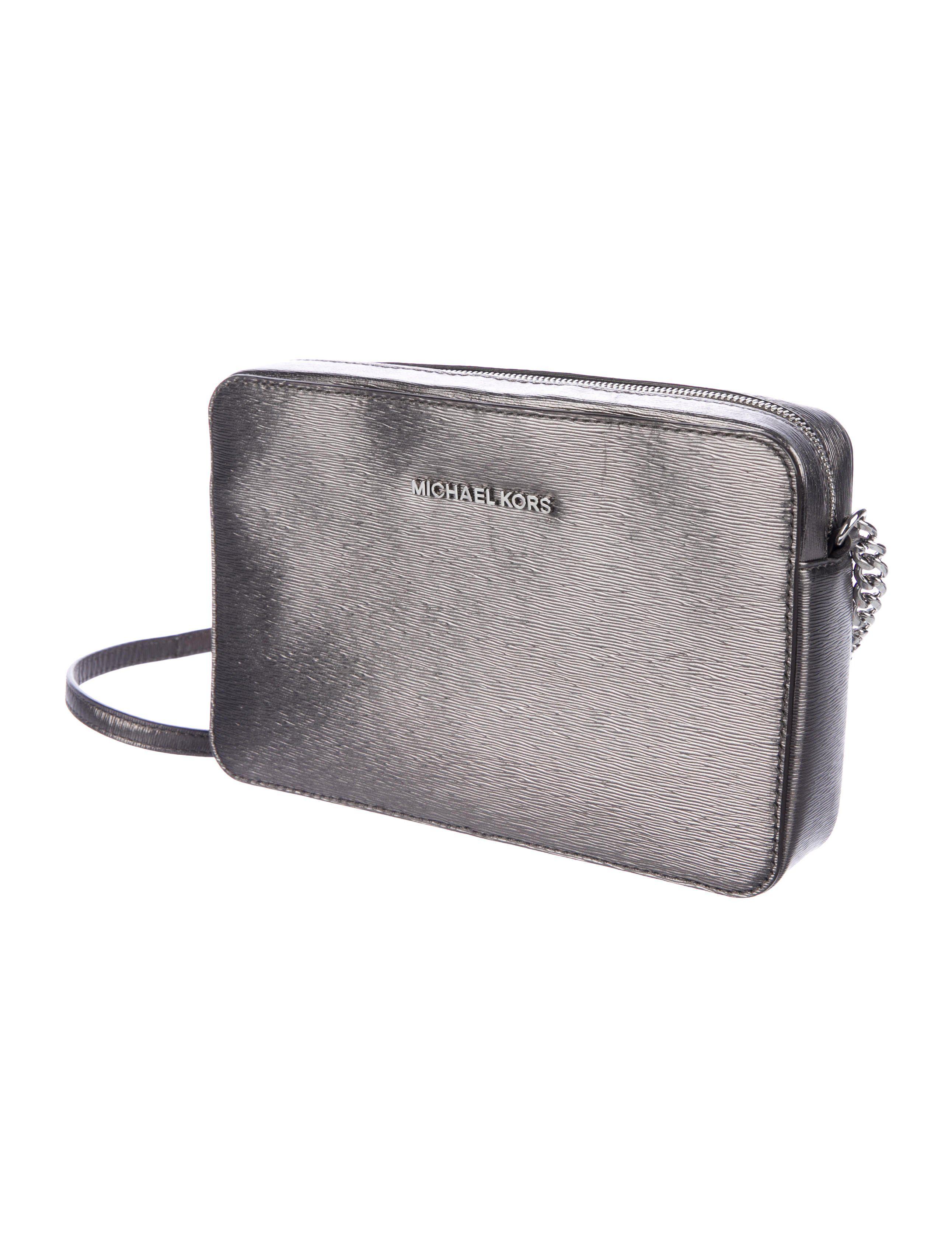 ac69ca35b7bc Metallic gunmetal saffiano leather Michael Michael Kors crossbody bag with  gold-tone hardware, single chain-link shoulder strap leather shoulder  guard, logo ...