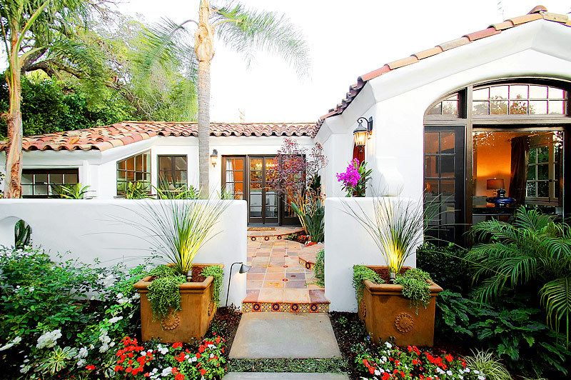 Spanish Colonial Bungalow With Blue Awnings