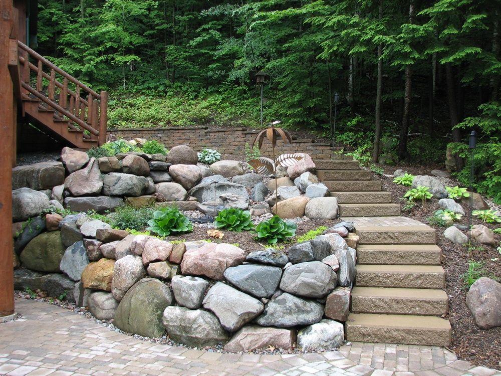 rock retaining wall along side of cedar deck Google