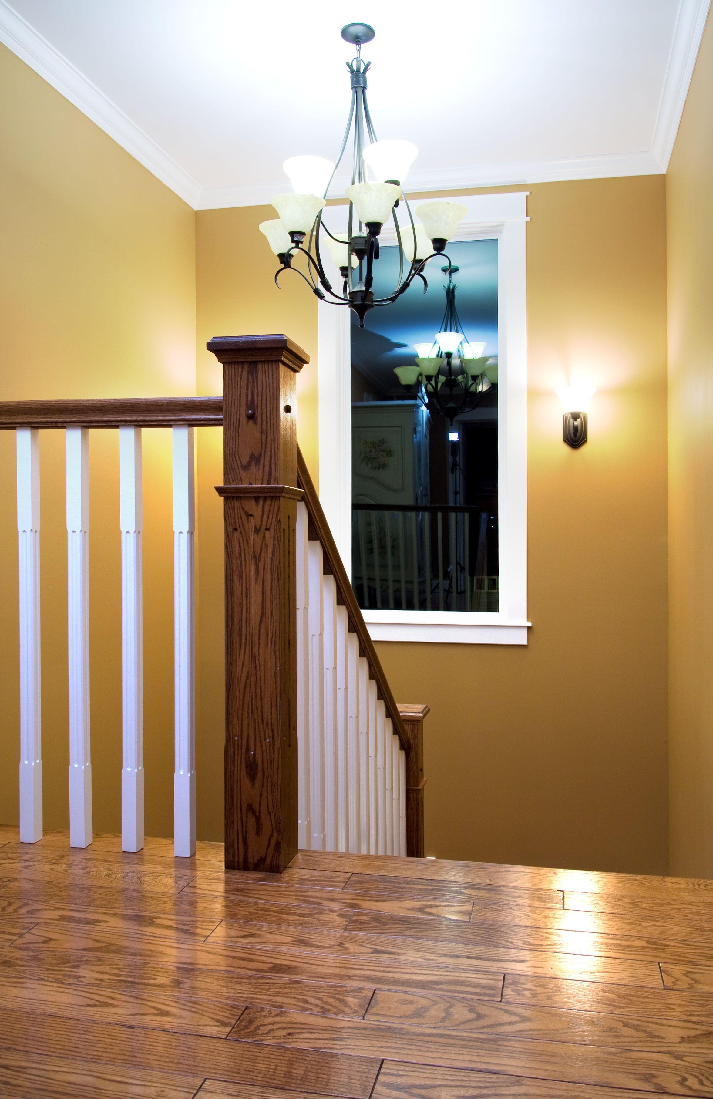 Distinctive interiors custom stair post and railings in