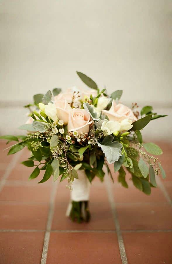 Hand Tied Wedding Bouquet Which Includes Champagne Blush Roses White Wax Flower Dusty Miller Green Seeded Eucalyptus Several Additional Varieties Of