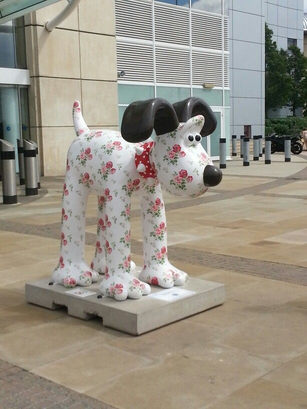 Cath Kidston Gromit Statue - For 10 weeks (Summer 2013), he was busy greeting visitors at Bristol's (United Kingdom) Cribbs Causeway Shopping Centre - one of over 90 giant 5ft sculptures transformed by artists and designers for the Gromit Unleashed public art trail. He was covered in the famous Antique Rose Bouquet print and proudly wore one of the Spot Red dog collars. All the designs were auctioned off to raise money for The Grand Appeal and our Gromit raised a whopping £30,000!