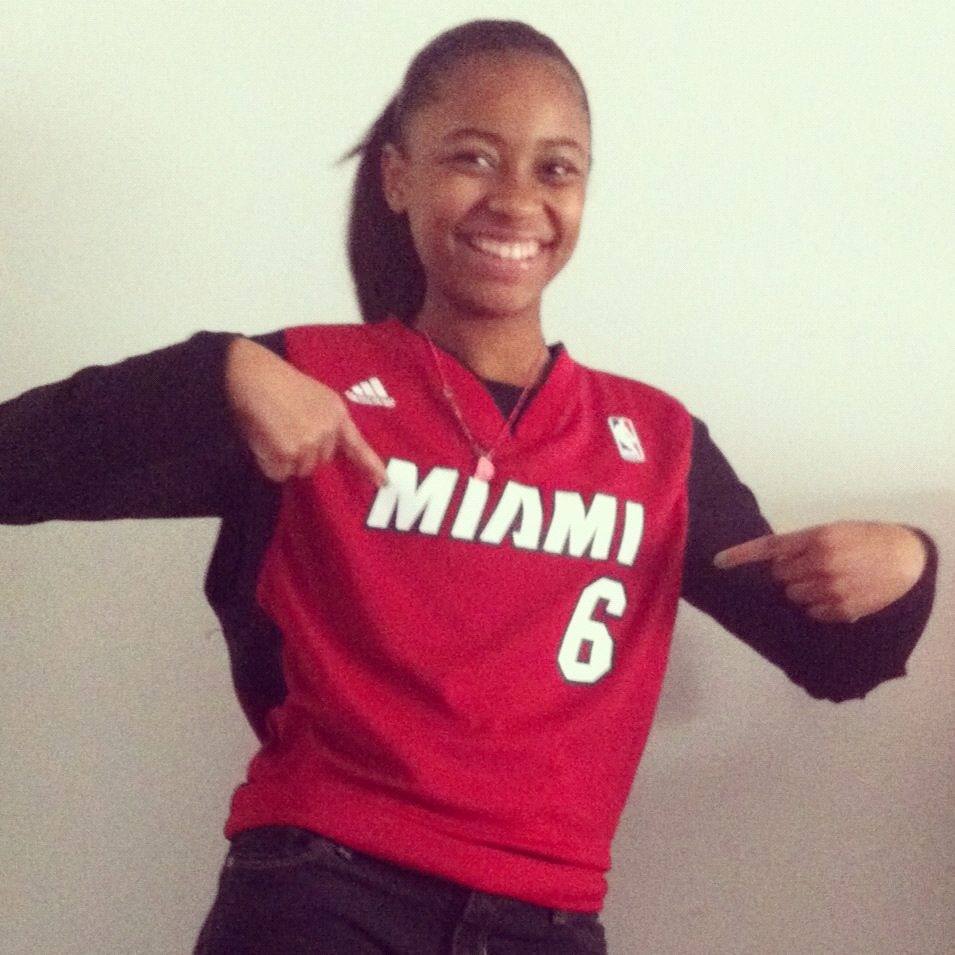 My daughter {lil ms b-ball player} sporting her Miami Heat - LeBron James jersey for spirit week!! :)