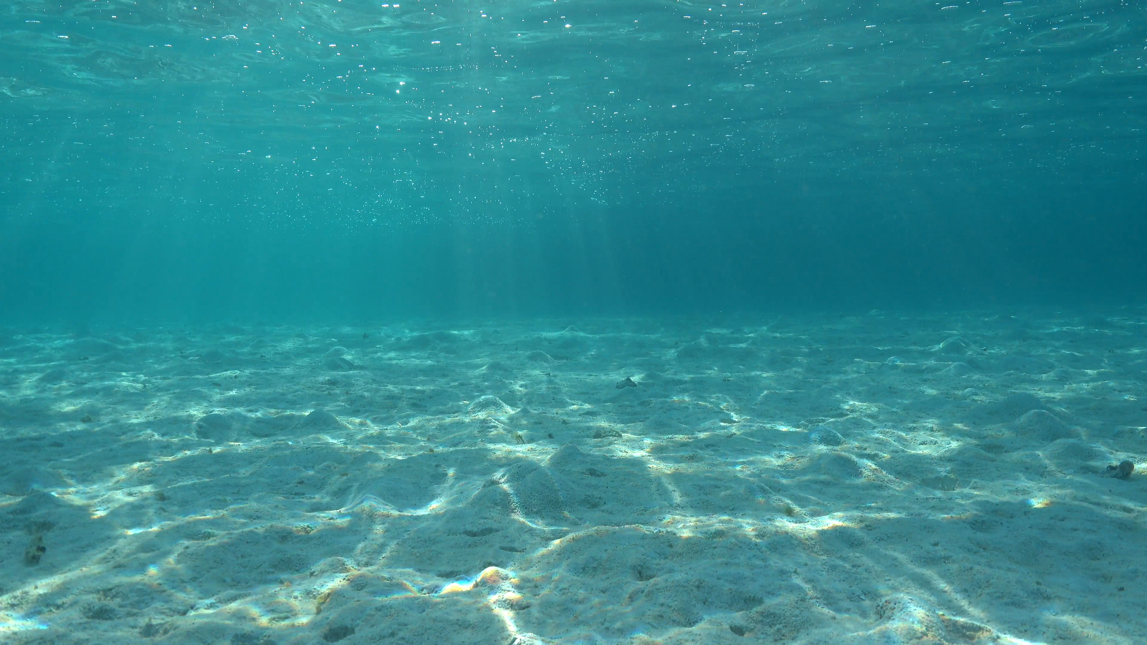 underwater-shallow-sandy-ocean-floor-with-sunlight-through ... Pacific Ocean Water