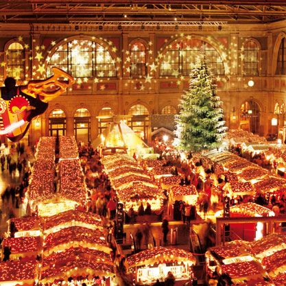 Switzerland has some of the most charming Christmas Markets - Basel, Bern and Zurich. This picture is of Zurichs & Christkindlimarkt; which is in a railway station & is Europes largest indoor Christmas market. The enormous tree is truely spectacular with its 5000+ Swarovski crystal ornaments.