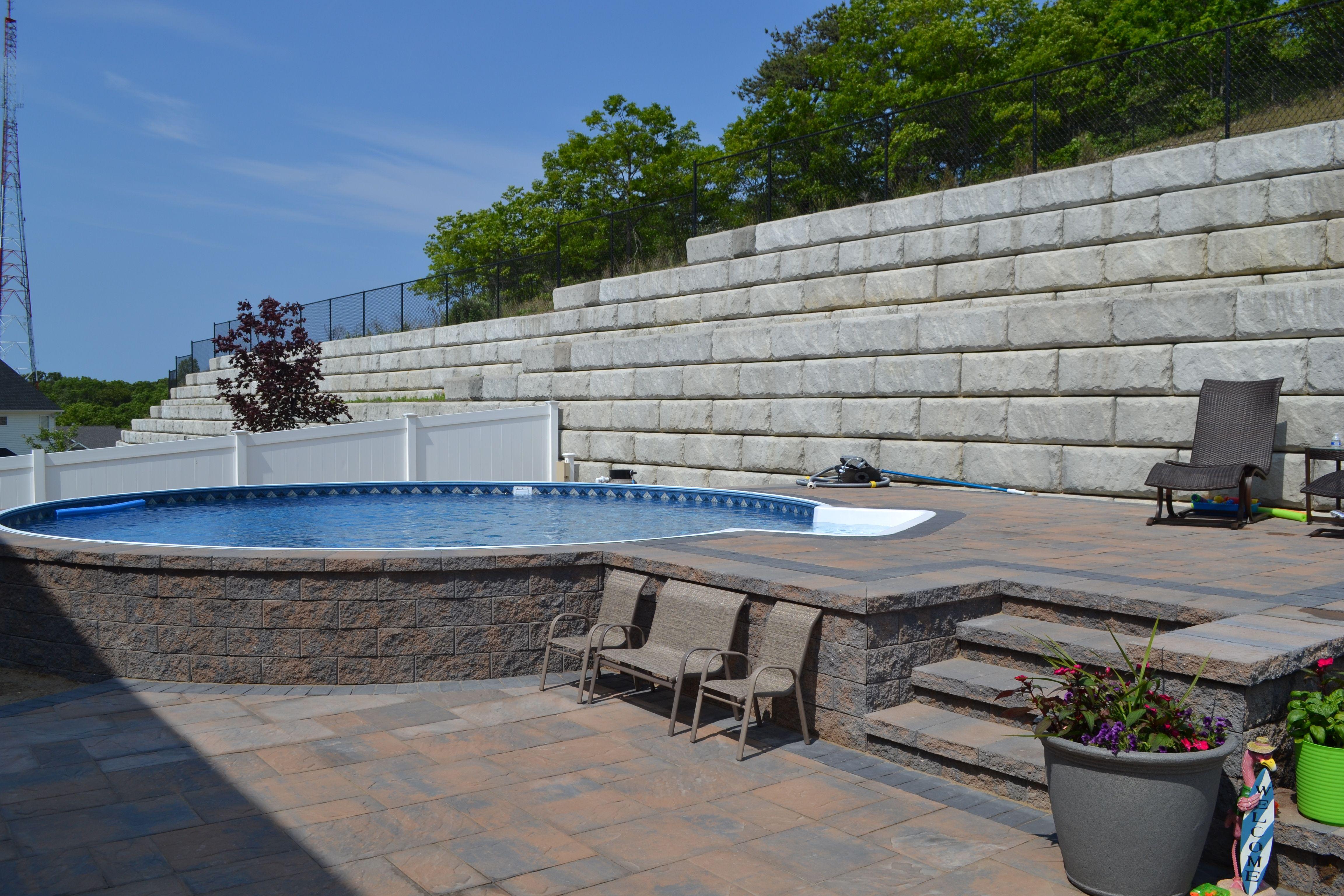 radiant semi-inground round with pavers | radiant pools backyard