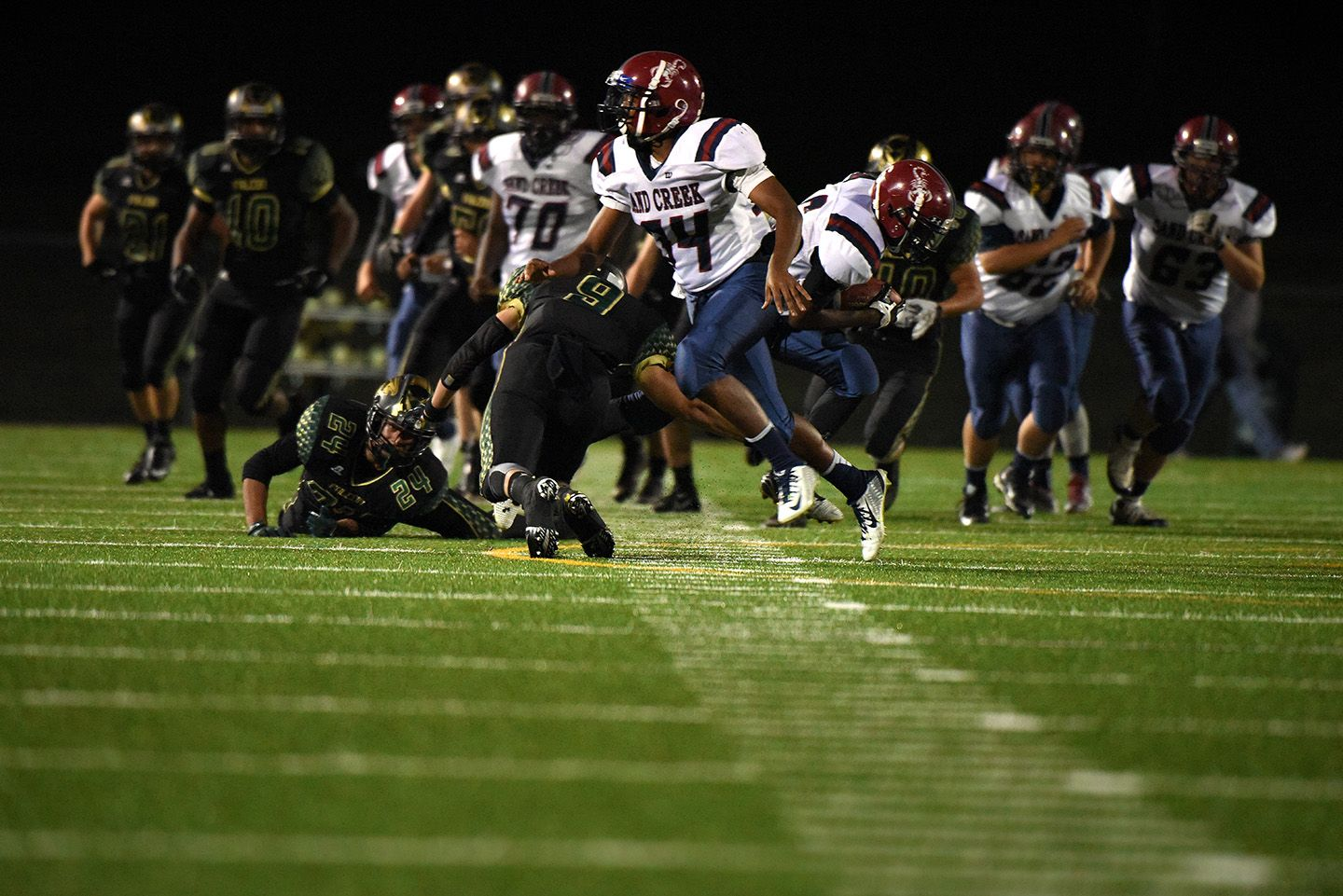The Falcons Rush The Scorpions Of Sand Creek High School During A Homecoming Football Game Oct 9 At Falcon High School In D Homecoming Football Games Football