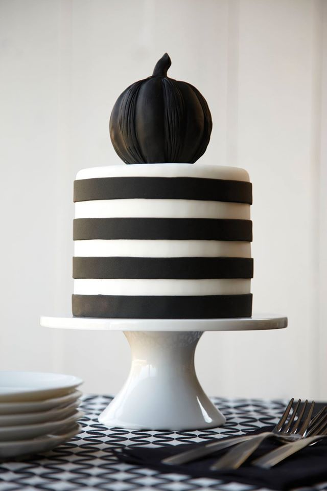 The darkness dazzles on this Black and White striped Halloween - wilton halloween cupcake decorations