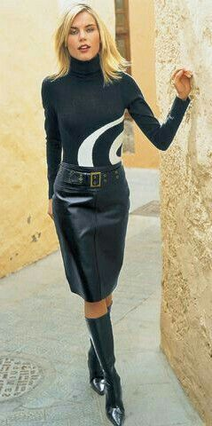 aff7ff7ebe35 Blonde in belted black leather skirt boots and sweater