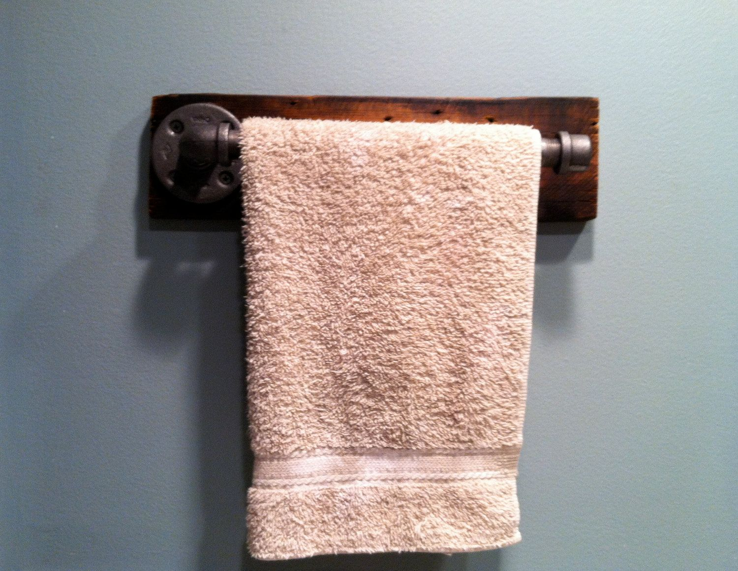 Industrial Towel Bar/Toilet Paper Holder/Bath Hook. $35.00, via Etsy.
