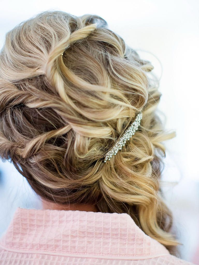Curled bridesmaid hairstyle swept to one side wedding hairstyles