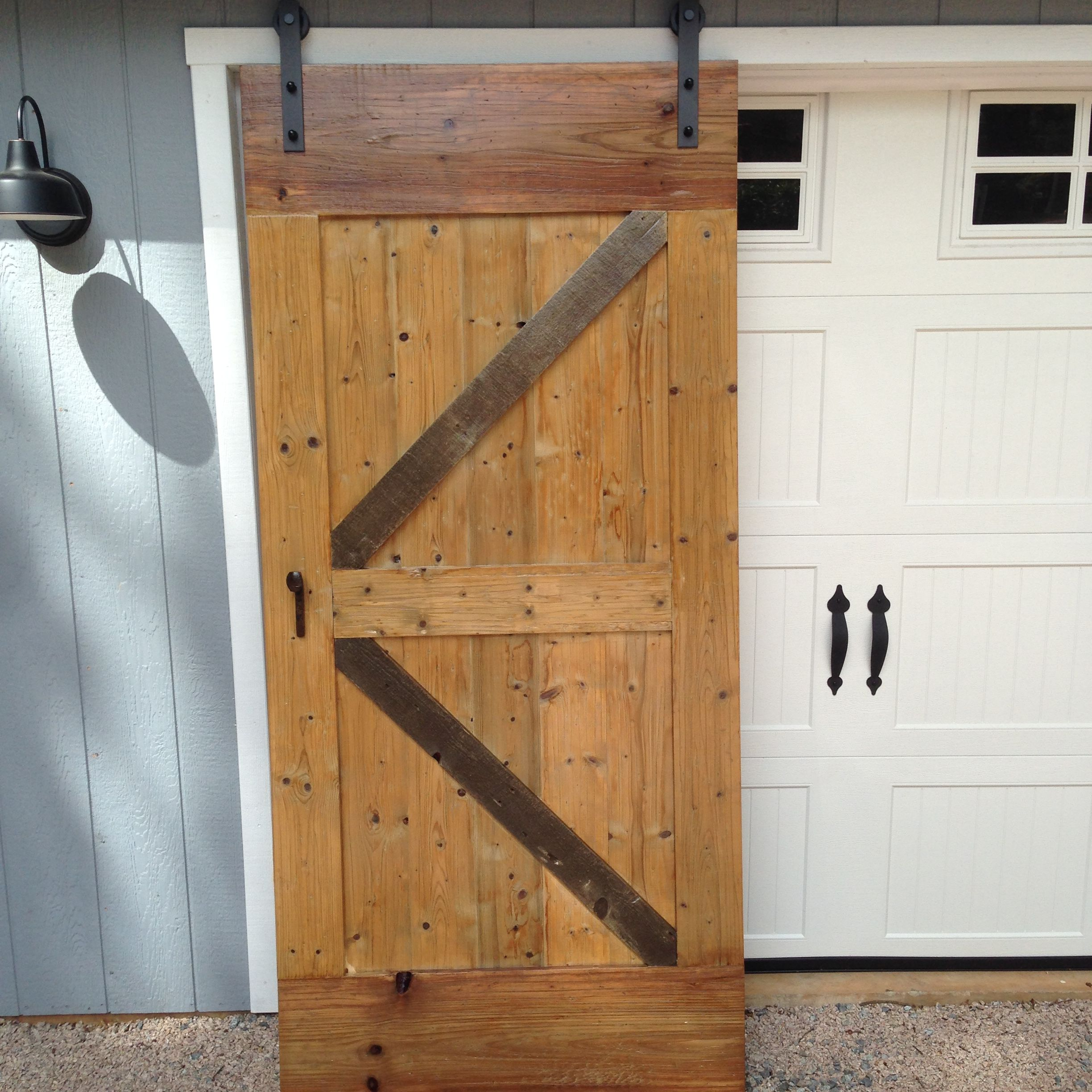 Southern Yellow Pine Door Distressed And Treated With Iron Oxide By Born In A Barn Cornelius Pine Doors Tall Cabinet Storage Barn Door