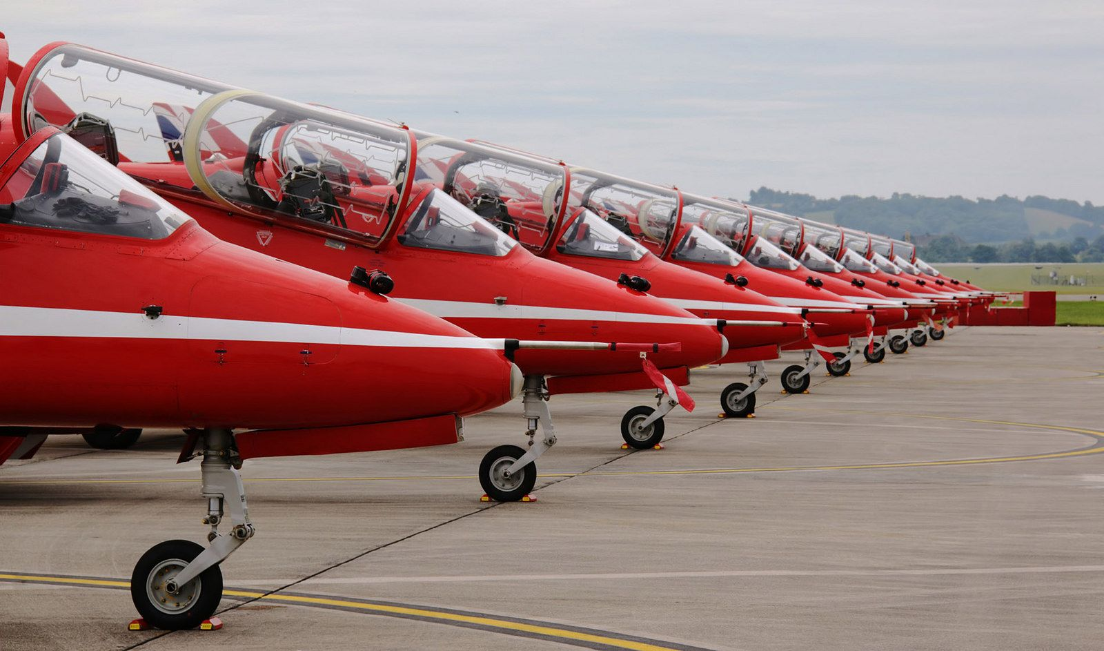 https://flic.kr/p/VtYVLd | The Crack Team | Precisely lined-up along an  apron expansion joint, all nine Royal Air Force Red Arrows Aerobatic Display Team BAE Hawks plus the spare await their display slot at the 2017 RNAS Yeovilton Air Day  IMG_0607