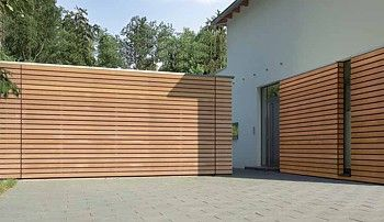 Hormann sectional garage door with timber slatted effect   Exterior ...