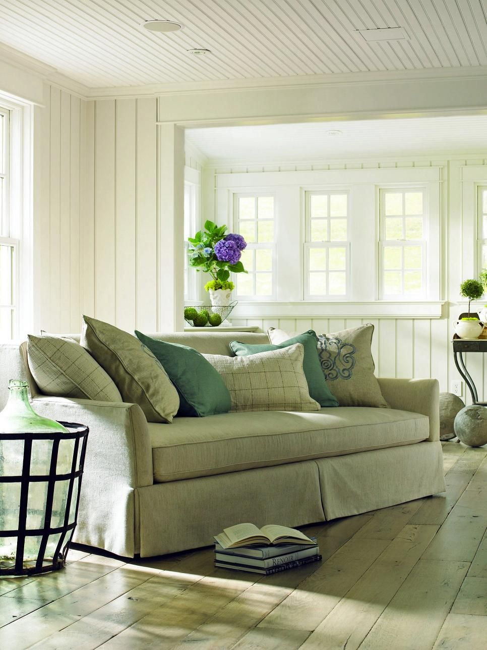 Anyone Will Feel At Home In This Shabby Chic Living Room With Light Green Paneled Walls