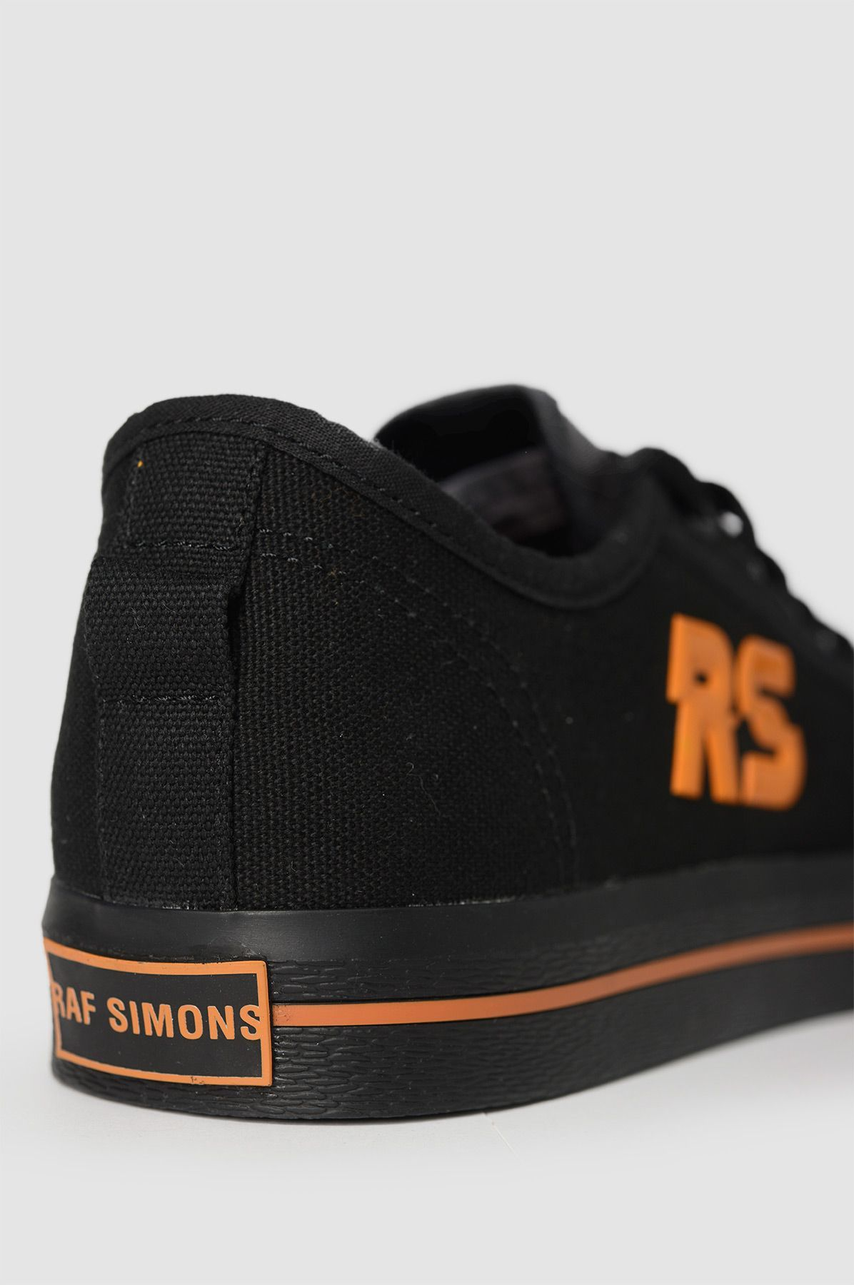 Man shop · ADIDAS X RAF SIMONS Spirit Low Black&Orange Sneakers.
