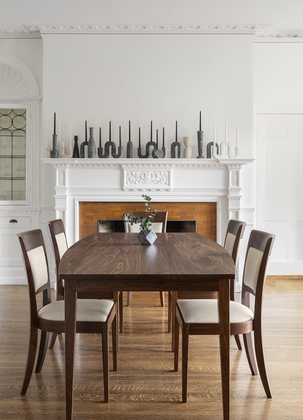 """Some things truly are timeless. Such as the pleasure of living with functional art every day. Our tables and chairs are handmade, resulting in both immediate and lasting joy. As one customer put it, """"functionally and ergonomically exquisite."""" Does the setting where family memories are made deserve anything less? #dining #diningroom #moderndining #diningroomtable #diningchairs #walnutfurniture"""