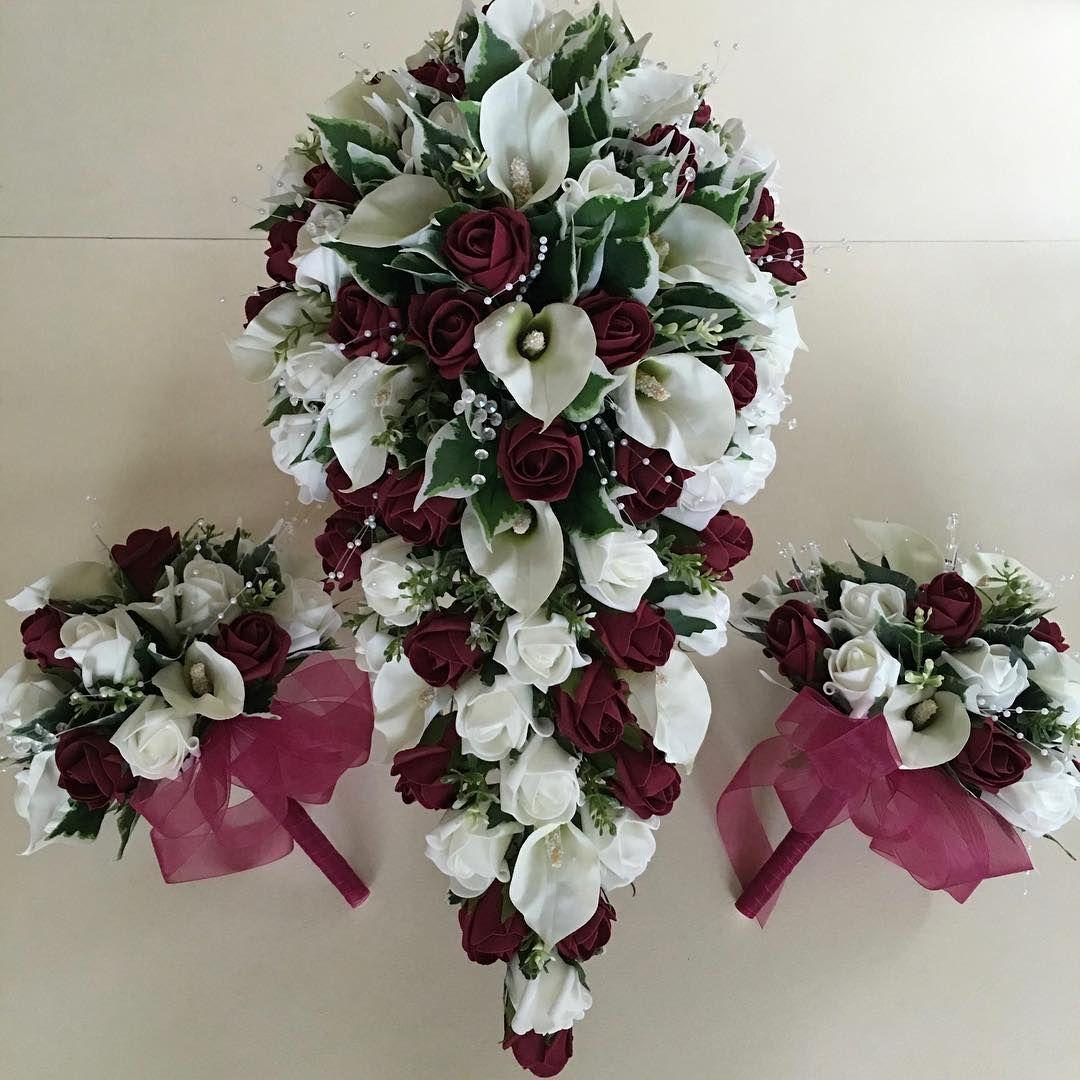Brides Teardrop Bouquet with Bridesmaids Posies.