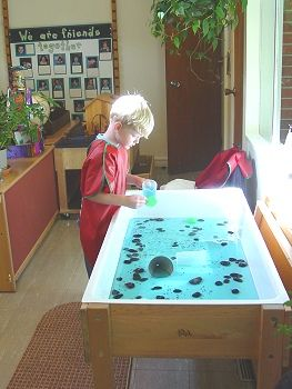 Ralph Waldo Emerson School for Preschoolers, Concord NH- the window light makes the water table even better.