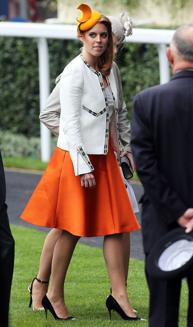 Princess Beatrice wore on trend orange, which she teamed