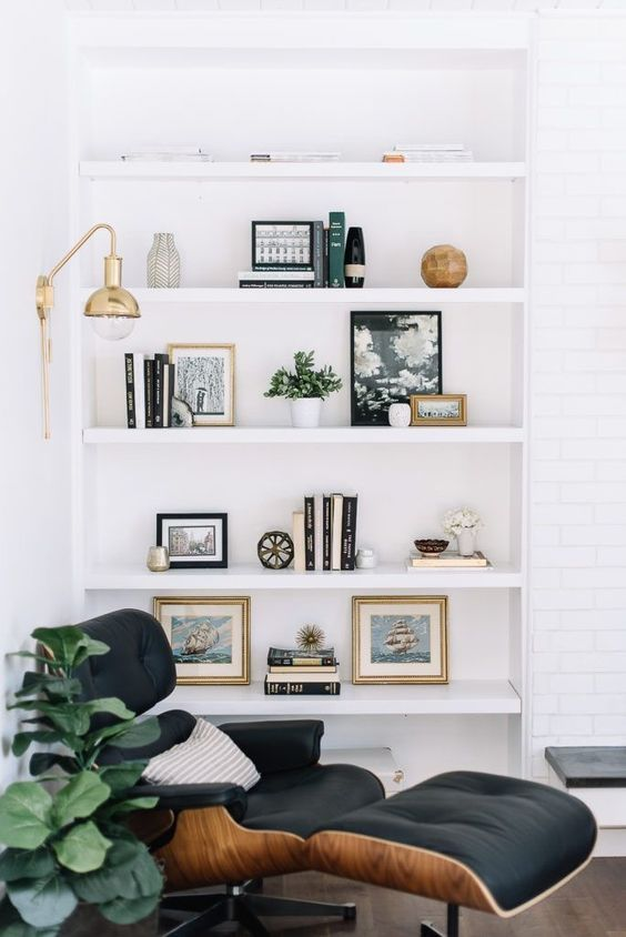 Modern And Scandinavian Living Room Bookshelf With Posters Books And Pots A Armch Living Room Scandinavian Mid Century Modern Living Room Home Decor Bedroom