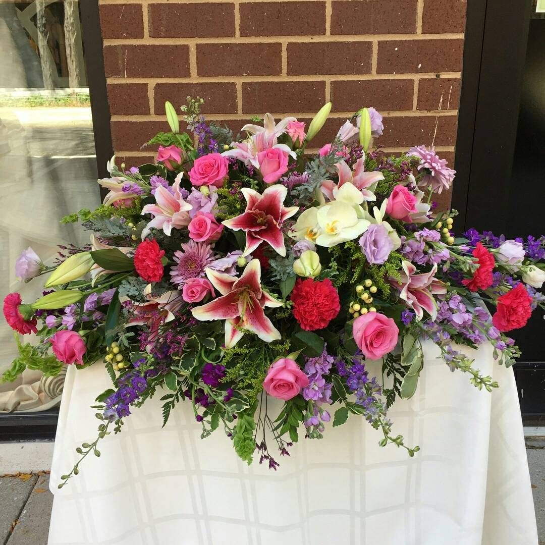 Another gorgeous casket display. #florist #flowers #flowershop #princetagram #nj #princeton #purple #pink