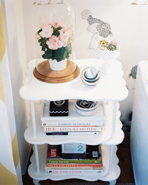 Michelle Adams - A white end table styled with books and flowers