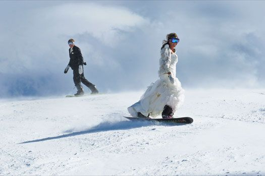 while I'm really feeling the winter wedding idea, I don't think I'll be snowboarding... in a wedding dress.  but it's quite fun that she did!