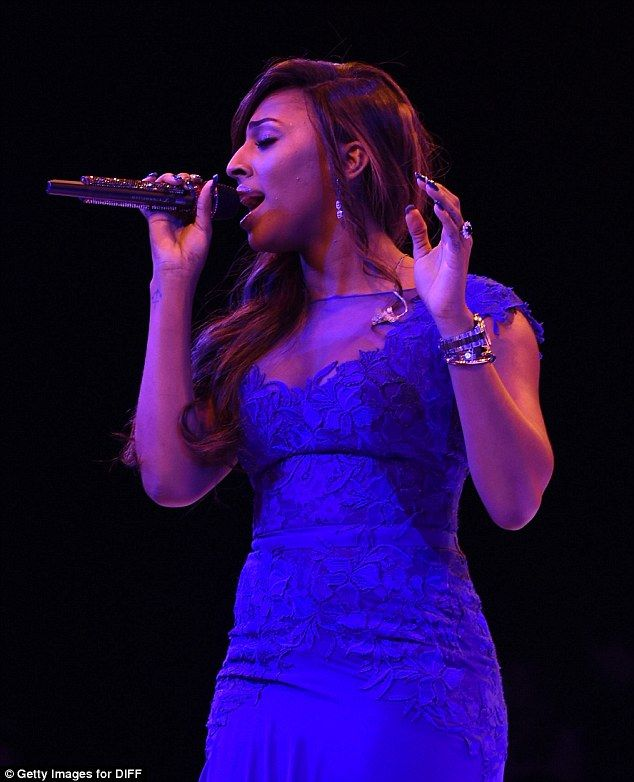 Feeling blue? Alexandra Burke clearly felt uncomfortable in the red dress - so witched to ...