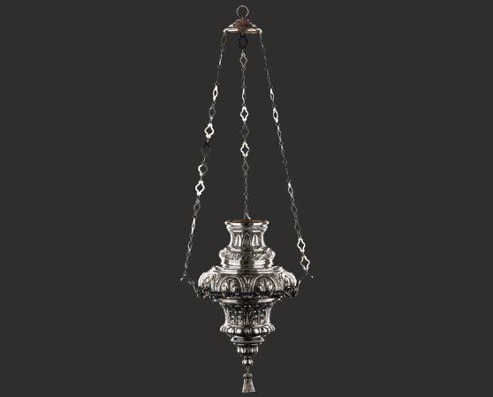 Lampada votiva in argento cesellato con foglie d'ornato