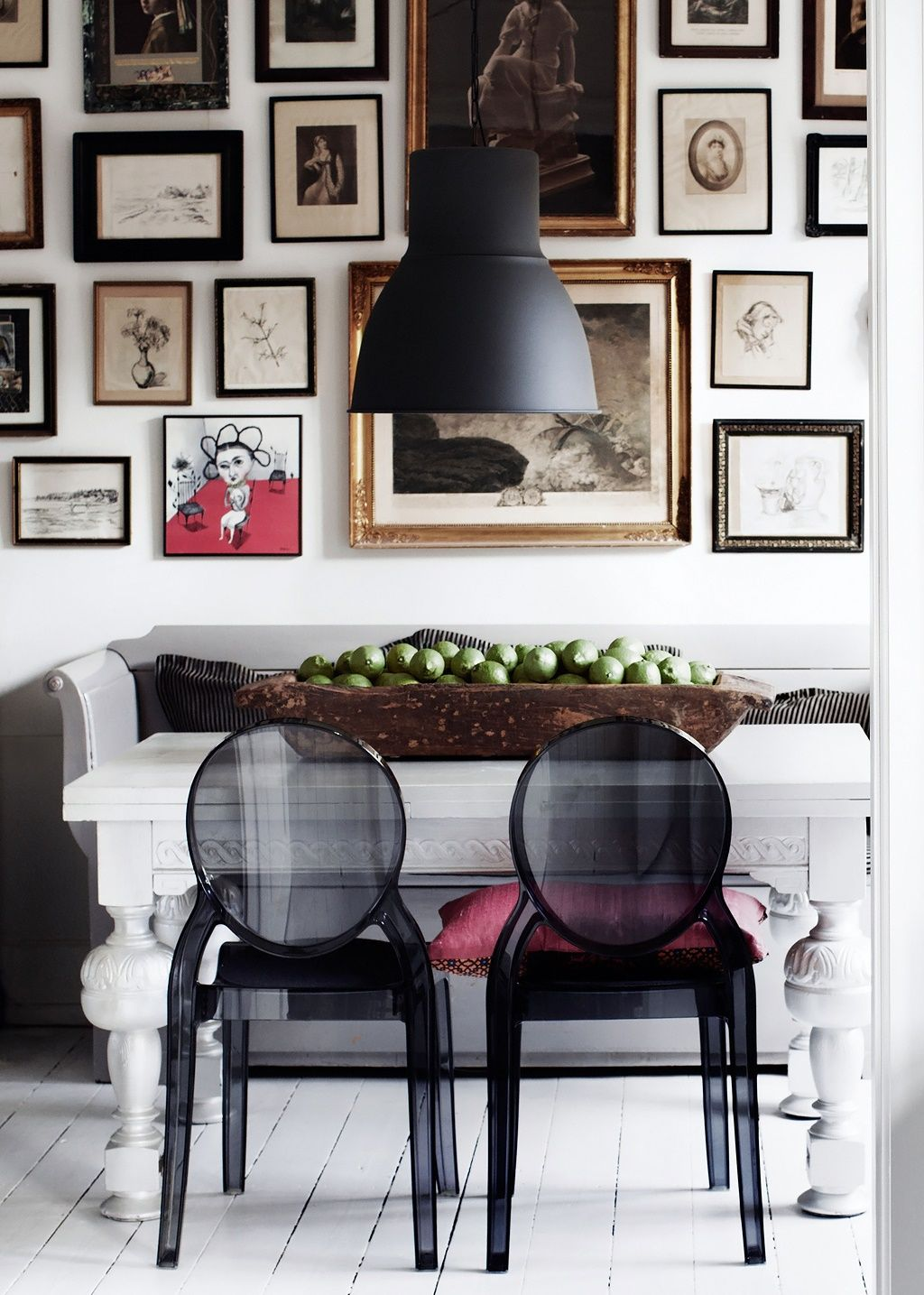 gallery wall with awesome lucite ghost chairs