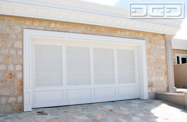 Shutter Style Garage Doors With A Louvered Design And Raised Bottom Panels.  Designed U0026 Crafted