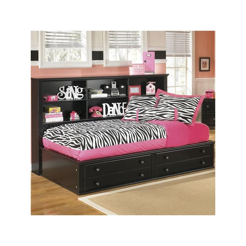 This trundle bed with built-in drawers and shelves is a cute space-saver