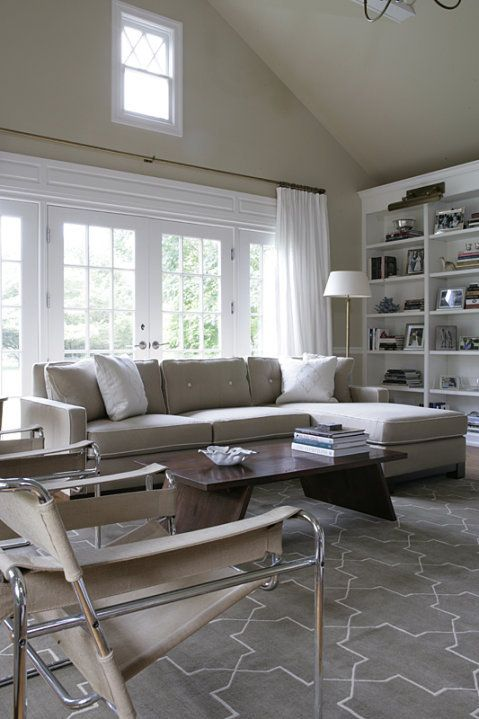 Chic Gray Living Room With Gray Velvet Sofa With Chaise Lounge, Marcel  Breuer Wassily Chairs, Wood Cocktail Table Over Madeline Weinrib Atelier  Steel Brooke ...