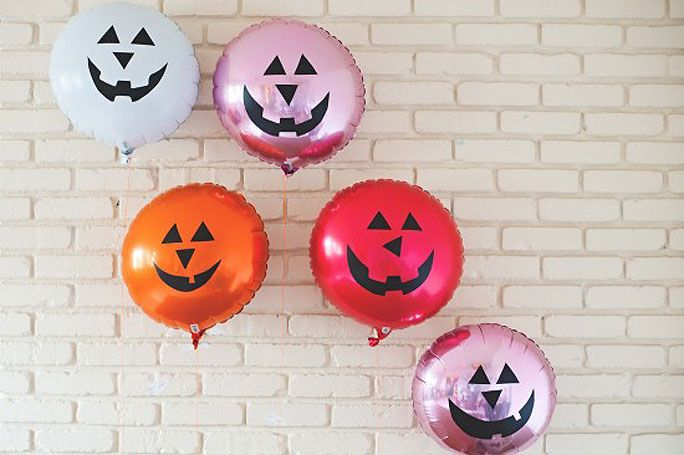 From Delightful DIYs to Best Buys: 10 Spooky-Chic Halloween Décor Ideas - Jack-O-Lantern Balloons  - from InStyle.com