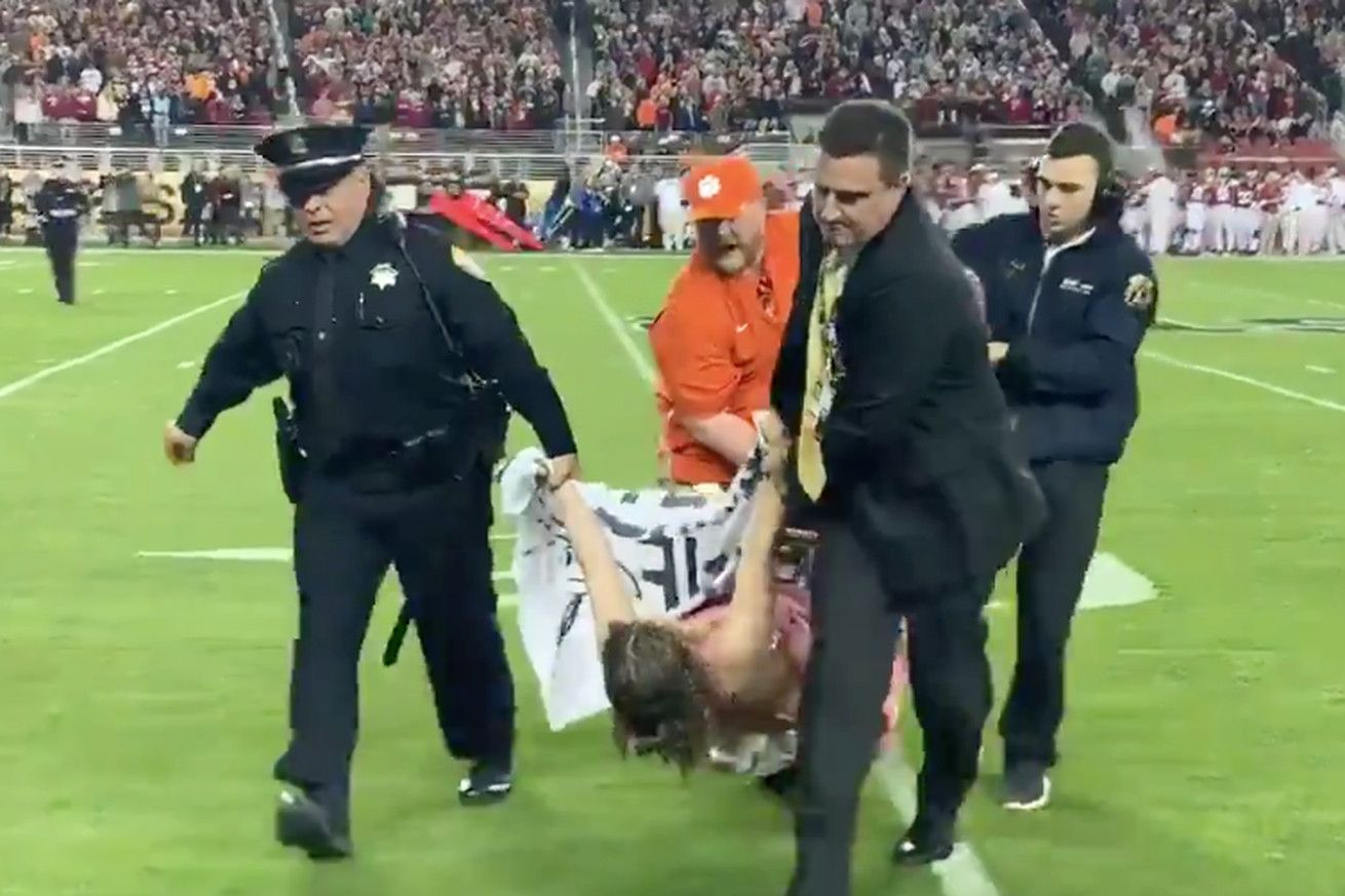 A fan ran onto the field in the opening minutes of Clemson
