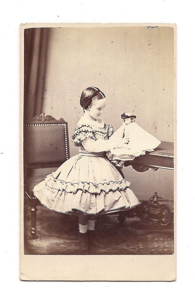 1860's CDV - LITTLE GIRL ADMIRING HER BISQUE? DOLL - WHIPPLE of BOSTON, MASS.