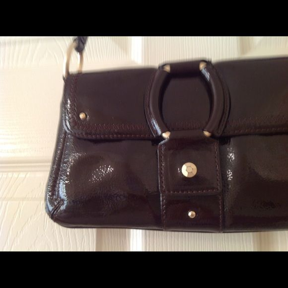 Vintage Sigrid Olson Crossbody Classy bag has 2 interior areas with 3 slits for credit cards.  Zippered compartment also has slip pocket for cell phone. Exterior slip pocket. Converts to shoulder strap. Magnetic closure. Sigrid Olsen Bags Crossbody Bags