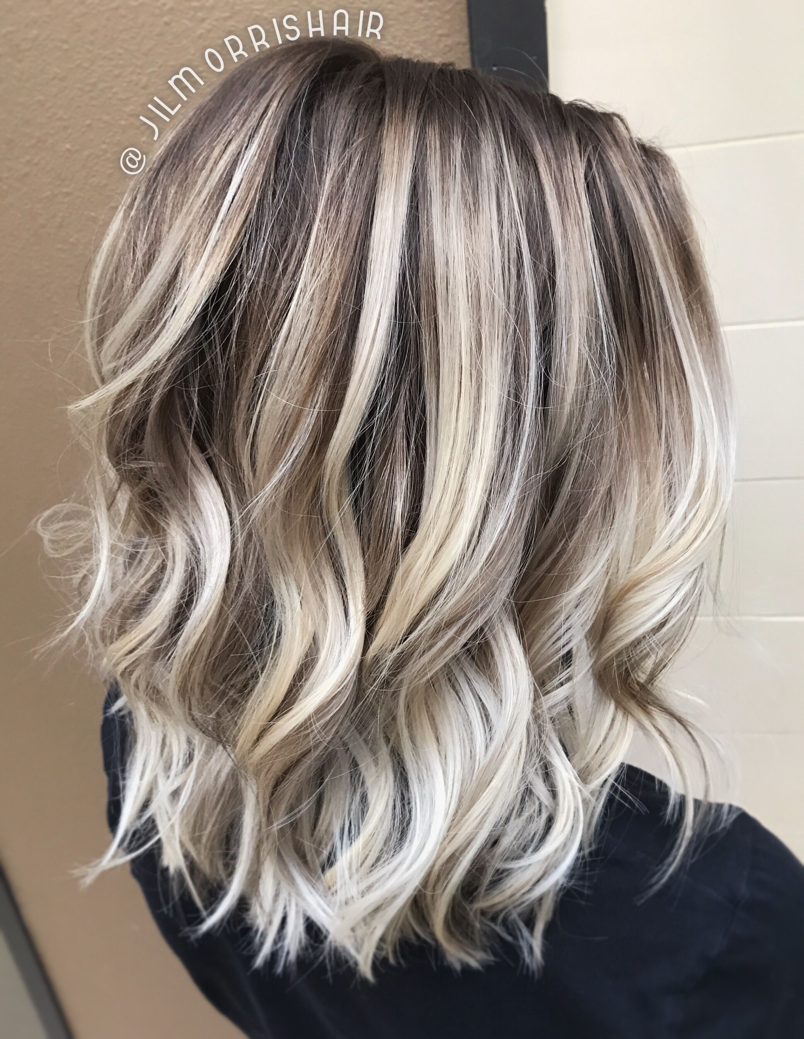 Cool icy ashy blonde balayage highlights shadow root waves and