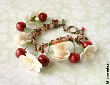 Tea and cherries bracelet. Features red cherries, small cherry-red beads, white cherry blossoms, tea cups, a tea pot, and a copper chain embellished with a pink ribbon. @ http://allim-lip.deviantart.com