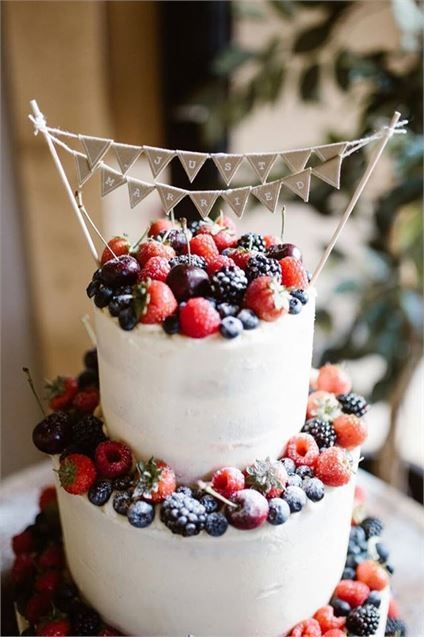 Add a summer twist to your cake with berries and bunting