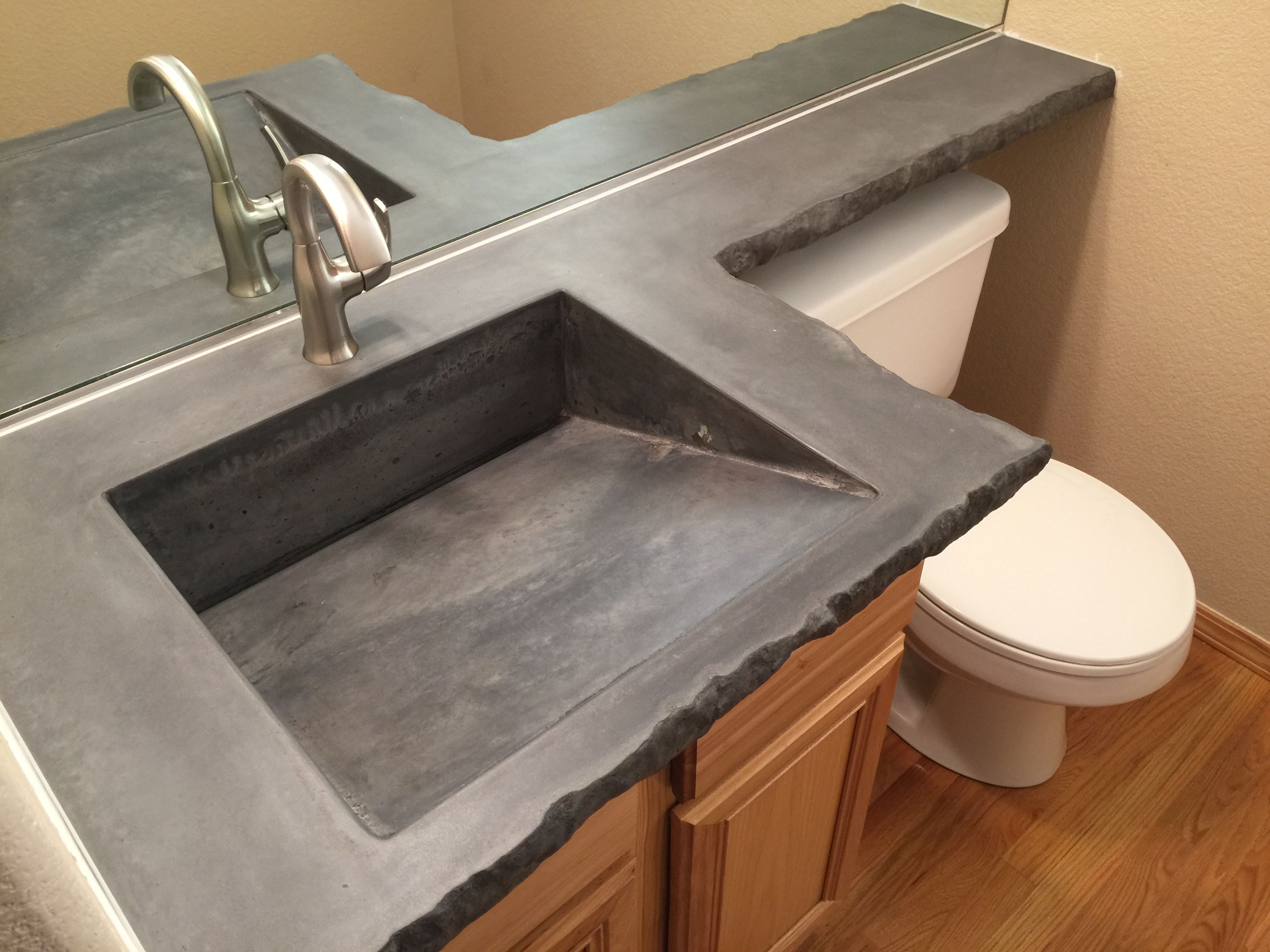 Custom Built Dark Grey Concrete Countertop With A Chiseled Rock