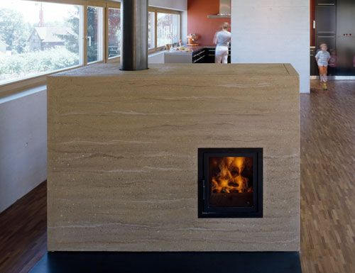 Rammed earth wood stove. Joint effort by Bertram and Harald Müller of  Müller Ofenbau and - Rammed Earth Wood Stove. Joint Effort By Bertram And Harald Müller