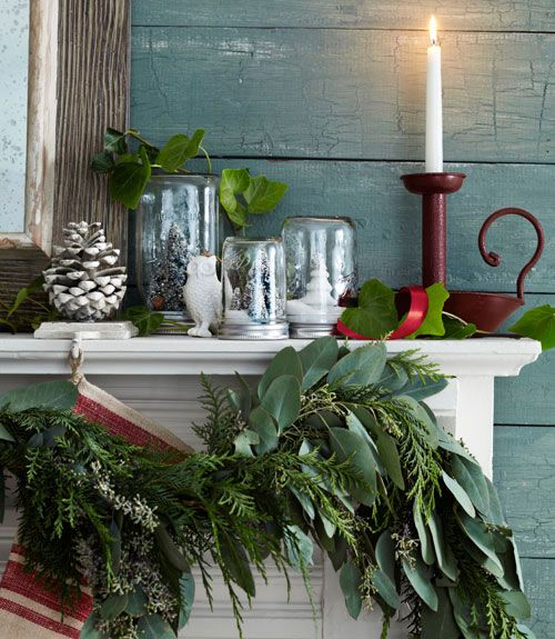 Give Mason jars a farmhouse-chic makeover by filling them with mini trees and snow, then placing them on your mantel.   - HouseBeautiful.com